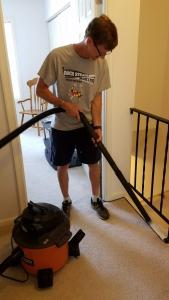 Pastor Mike from Living Grace Lutheran Church Vacuuming and House Sitting for a Homeowner who Had an Emergency